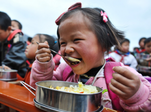 Helping provide school lunches for children across rural China.