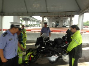 motorcycle repairs in a police tent