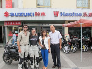 At the Jiayguan shop with owner and wife